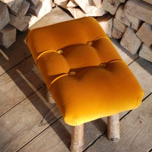 Classic furniture piece with buttoned seat. Footstool, child's chair, heirloom furniture